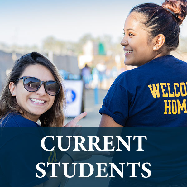 Two female students wearing UC Merced shirts